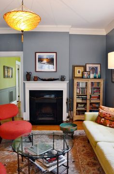 Pretty bluish gray, looks great with the other colors.  ~Deborah  Eva & Philip's Art-Filled Wanderlust Home