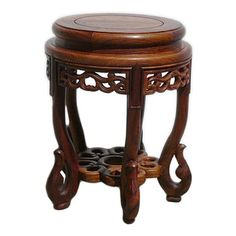 Golden Lotus - Chinese Huali Rosewood Round Scroll Leg Stool - This is a hand made round wood stool with oriental style of scroll legs and flower pattern on the body. It can be a sitting stool or a stand.