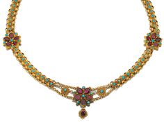 GOLD AND GEM SET NECKLACE, EARLY 19TH CENTURY.  The canetille work links highlighted at intervals with floral motifs set with oval foil backed garnets and cabochon turquoises, length approximately 430mm.