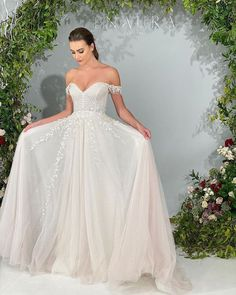 Illusion long sleeves with vine like beading throughout sleeves and bodice, blush tiered tulle A-line skirt. #lorigown #enaurabridal #blushweddingdress Popular Wedding Dresses, Garden Wedding Dresses, Bridal Wedding Dresses, Bridal Style, Princess Ball Gowns, Gowns With Sleeves, Ball Gown Dresses, Dress Collection, Illusion