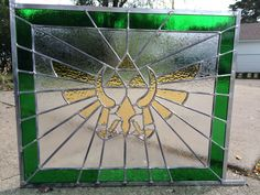 Legend of Zelda Leaded Glass Window - For my son, who is a big LoZ fan! Stained Glass Designs, Stained Glass Patterns, The Legend Of Zelda, Nintendo Decor, Michael Christmas, Star Trek, Nerd Cave, Nerd Crafts, Gamer Room