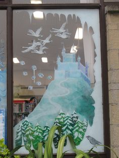 Snow Queen window mural detail - Snow Queen's castle and flying swans as seen from outside.