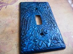 This vibrant blue light switch cover will brighten any room with it's pearly vibrant blue patterned print.  ** This is a standard size light switch cover cast with polymer clay and comes with two screws.