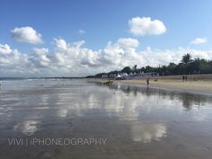 Picture perfect mirror effect on the sands. My early morning walk in Kuta Beach, Bali-Indonesia.