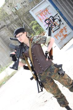 girl with a lot of airsoft guns