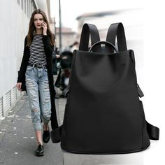 #taobao took a risk with this (pretty) one... black canvas backpack, 11SGD
