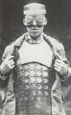 "1917: British Body Armour	  ""The 'EOB' armour was designed by the Munitions Inventions Board, worn with a protective collar, made of layers of compressed silk padded within canvas. Weighing in at 9 ½ pounds, the system would stop pistol rounds, shrapnel and grenades."""