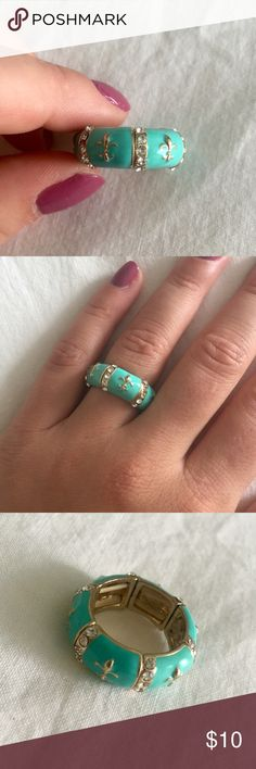 Aqua & Gold Ring Aqua and gold ring with jewels. Stretchy to fit all finger sizes. Worn only once, great condition! Francesca's Collections Jewelry Rings