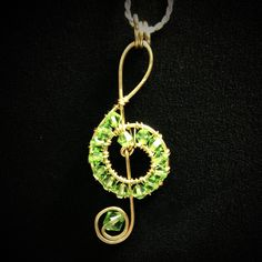 Swarovski w/ gold wire music note