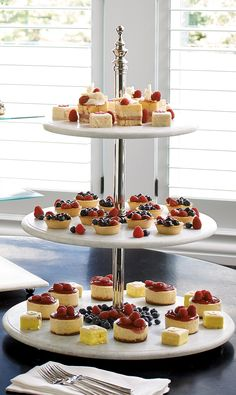 Stage your cheeses, fruits, pastries or cupcakes on elegantly tiered trays with our Round Marble Tiered Etagere.