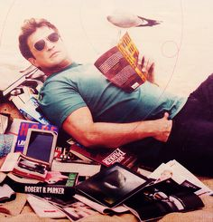 This may be the hottest thing ever! Nathan Fillion in a pile of books.