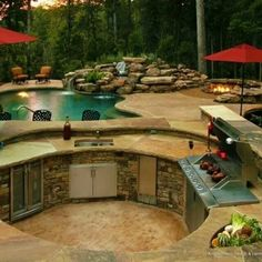 As far as dream patios go, this one sure has it all: a pool, a forest, and even its own underground cookout.
