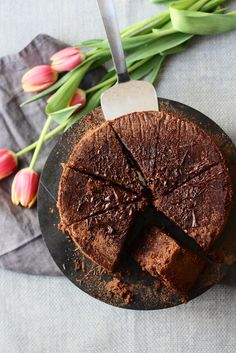FLOURLESS CHOCOLATE-FIG CAKE. It's a dense beautiful flourless cake. Figs add a subtle but elegant touch to this chocolatey cake. Easy and perfect with some ice cream.