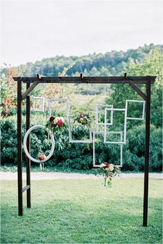 Hanging pictures frames wedding | Image by Alexander James, Styling by Lavender & Rose Planners