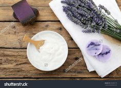 Cosmetic Cream And Lavender Flowers On White Towel Wooden Table Background Stock Photo 445589179 : Shutterstock