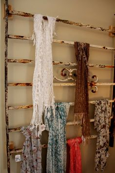 old fence piece is used to display scarves
