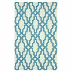 Hand-hooked wool rug with a blue trellis motif.  Product: RugConstruction Material: 100% WoolColor: BlueFeatures: Hand-hookedNote: Please be aware that actual colors may vary from those shown on your screen. Accent rugs may also not show the entire pattern that the corresponding area rugs have.Cleaning and Care: Spot treat with a mild detergent and water.  Professional cleaning is recommended if necessary.