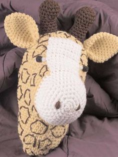 Crochet this giraffe head using worsted-weight yarn, add a mop handle and create hours of fun for the toddler in your house.