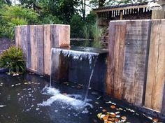 Tuinaanleg | maken van een tuin met vijver en overkapping