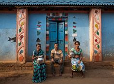 "Namdeo poses with his wives Shivarti (L) and Bagabai (R) outside their house in Denganmal village, Maharashtra, India, April 21, 2015. In Denganmal, a village in Maharashtra state, some men take a second or third wife just to make sure their households have enough drinking water. Becoming what are known as ""water wives"" allows the women, often widows or single mothers, to regain respect in conservative rural India by carrying water..."
