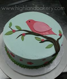 Cake with bird on a branch.