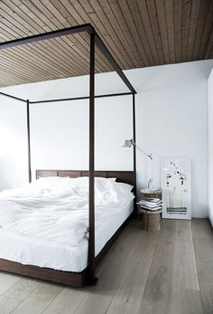 A large bed in an amazing nordic styled house
