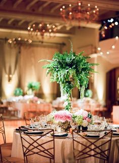 photographer: The De Jaureguis; Wedding reception centerpiece idea