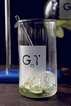 [GnT beaker]    etched lab beaker with glass stirring rod.