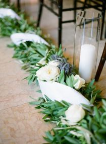 Big garland (fake if need be), ribbon, baby's breath? and dollar store vases for candles?