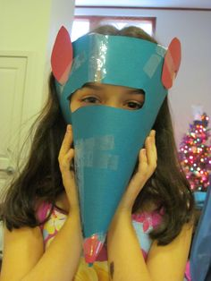My daughter made this Nutcracker Mouse Mask. It would be a great craft to do at a Nutcracker Ballet party.