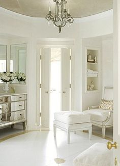 What a gorgeous and girly closet! I could lounge here with a glass of champagne deciding what to wear for the evening!