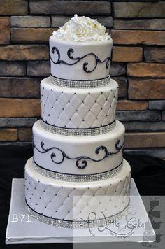 "Purple fondant wedding cake! Not a fan of the ""diamonds"", but that's an easy fix! ;)"