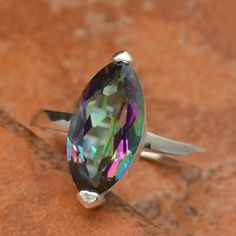 Mystic Topaz Ring 925 SZ 9 Coven Witch Blessed Wicca Amulet for Good Luck Fortune Wealth Health Happiness Love. I love the color. Not the shape tho. 2.5 stars