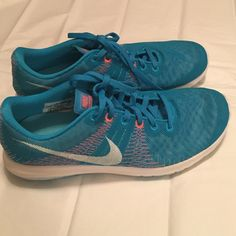 Only wore once!! Nike fury! Only wore once! Blue and orange! Very nice Nike Shoes Athletic Shoes