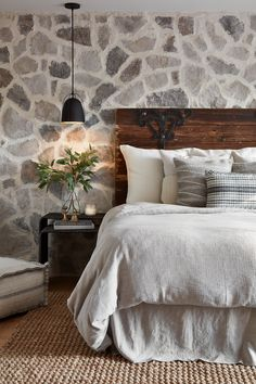 The first thing your eye is drawn to in the master bedroom is the stonework on the focal wall. I love the variation of colors in the stone and how it balances out the modern, black french doors and light fixtures. By tying this wall into the interior and exterior fireplace, this feature immediately takes away any feeling of it being a garage conversion, and makes it seem like this room has always been there.