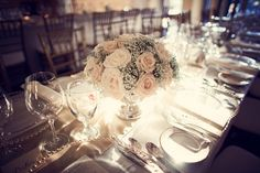 Beautiful garden roses and baby's breath in a low bowl. Photo by Kevin Paul Photography. #wedding #centerpieces