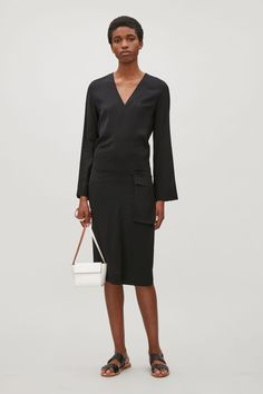 COS image 1 of Dress with draped pocket in Black