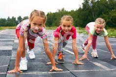 girls starting to run on track royalty-free stock photo