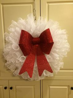 White spiral deco mesh red bow Christmas wreath