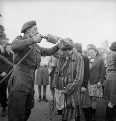 George Rodger. A British doctor uses DDT while delousing newly freed female prisoners at the Bergen-Belsen concentration camp 1945 [ DDT..!]