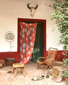 old wooden doors with exterior fabric drape, photo: Lucy Attwater