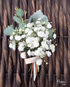 Groom's Boutonniere desinged with Baby's Breath, Dusty Miller & Eucalyptus