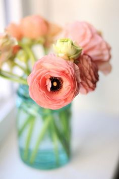 pink anemones and ranunculus in a blue mason jar.  Classic and beautiful!