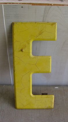 Vintage Letter E Sign - Yellow - Rusty Metal Chippy - Industrial Retro Shabby Chic. $16.00, via Etsy.