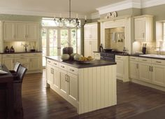 A cream country kitchen in a traditional tongue and groove style