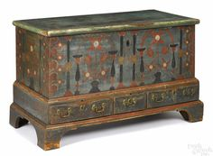 """Berks County, Pennsylvania painted pine dower chest, dated 1798, with tulip and pinwheel flowers on a blue/green ground and heart corners, above three drawers supported by bracket feet, 30"""" H. x 46-1/2"""" W."""