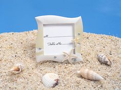 "This is for a set of 24 beach place card holders, but you can purchase any quantity. Message us for pricing. We offer discounts for large purchases. Our beach place card frames in sand and white colors are perfect for your beach themed wedding. Each frame is accented with starfish design and crystals. They measure 3"" x 3"" and hold a 2x2 photo (Place card included)."