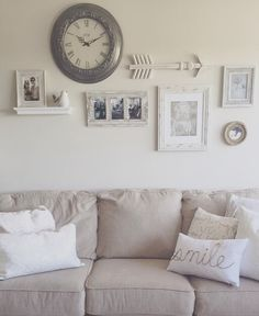 Over the couch decor. Beige-gray-greige. Use a clock as your focal point & work around it. A shelf for dimension! Arrows break up 90 degree angles of the frames! Add some personal photos in black/white scale to keep your wall looking clean, while adding some character! Finish off the look with some decorative pillows.   Shabby chic. Paint: calico cream sherwin Williams.  Couch: milari sofa  Pillows: homegoods  Wall decor: homegoods