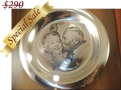 "FREE $25 Gift Certificate with $25 or more purchase!  DreamLand Specialties is pleased to be able to offer exceptionally fine heirloom treasures that are perfect for gift giving or any collection.   Offering: Solid Sterling Silver 183.7 gram Marked Norman Rockwell ""Under the Mistletoe""      ..."