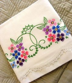 My grandmother used to embroider pillow cases like this. They were very pretty.